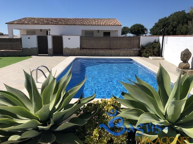 casa con piscina compartida