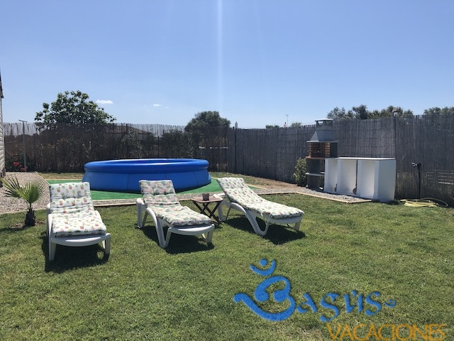Casa Dunita en el palmar, jardin grande, cerca de la playa, piscina hinchable para niños